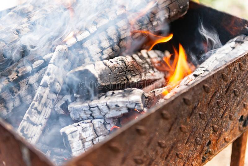 Fire in brazier. Ð¡hargrill with burning wood. Prepare charcoal before grilling meat royalty free stock images