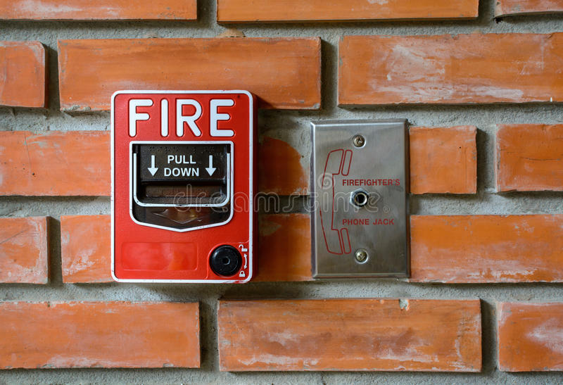 Fire break glass alarm switch on brick wall royalty free stock photo