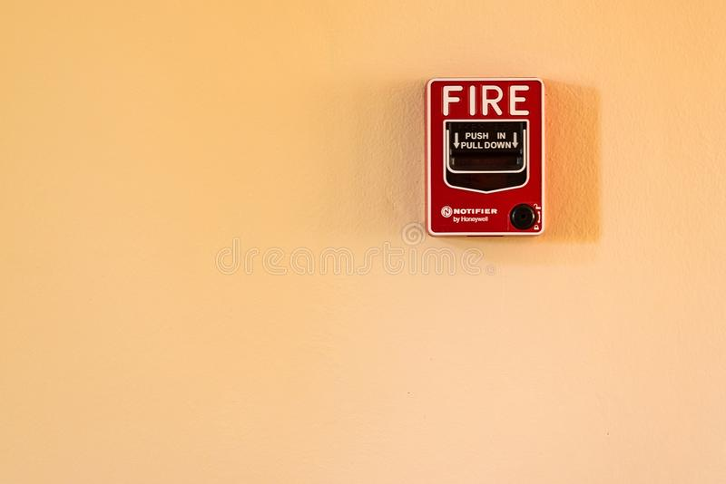 Fire break glass alarm switch on the cement wall. royalty free stock image