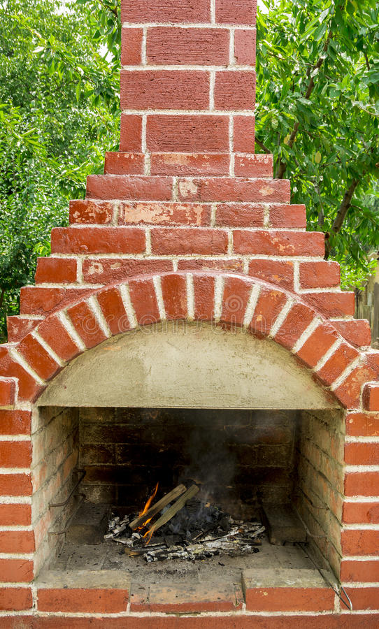 Fire in brick barbecue royalty free stock photo