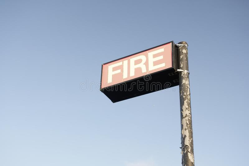Fire brigade station sign in empty blank blue sky. Uk stock images