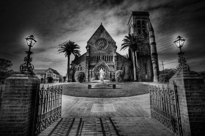 Fire and brimstone. Old Australia church with moody editing stock photos