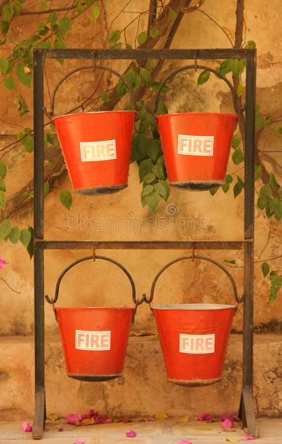 Fire buckets ready for use. Fire buckets are ready for use outside a building in the city of Mandawa, India stock photo