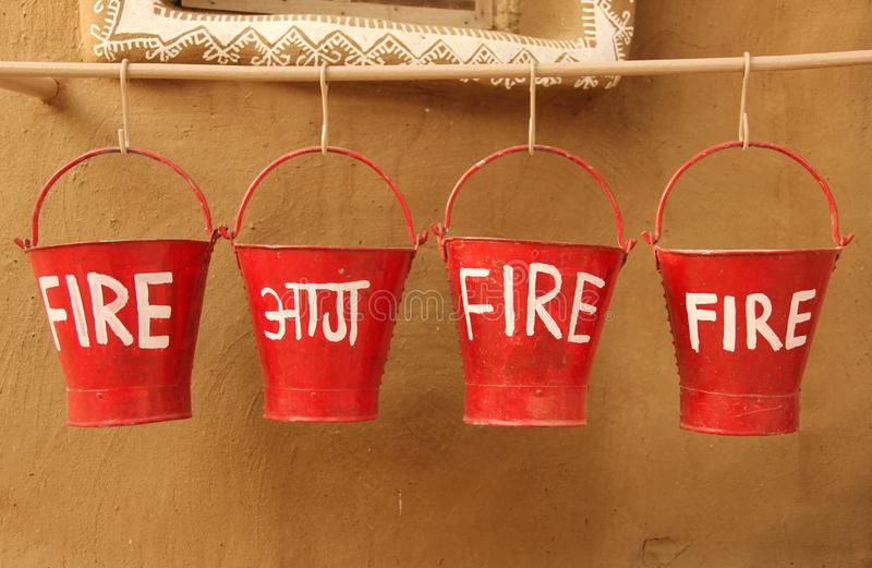Fire buckets ready for use. Fire buckets are ready for use outside a building in the city of Mandawa, India royalty free stock images