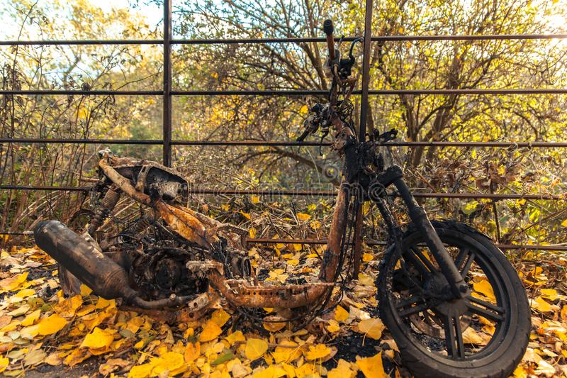Fire burn on motorcycle after being torched in glasgow. Scotland royalty free stock images