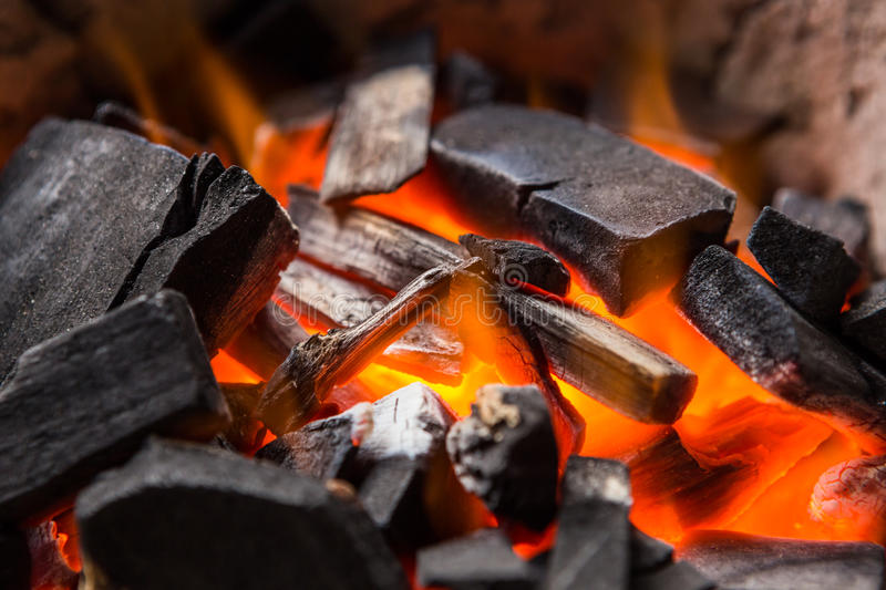 Burning charcoal. Fire burning charcoal close up stock photography