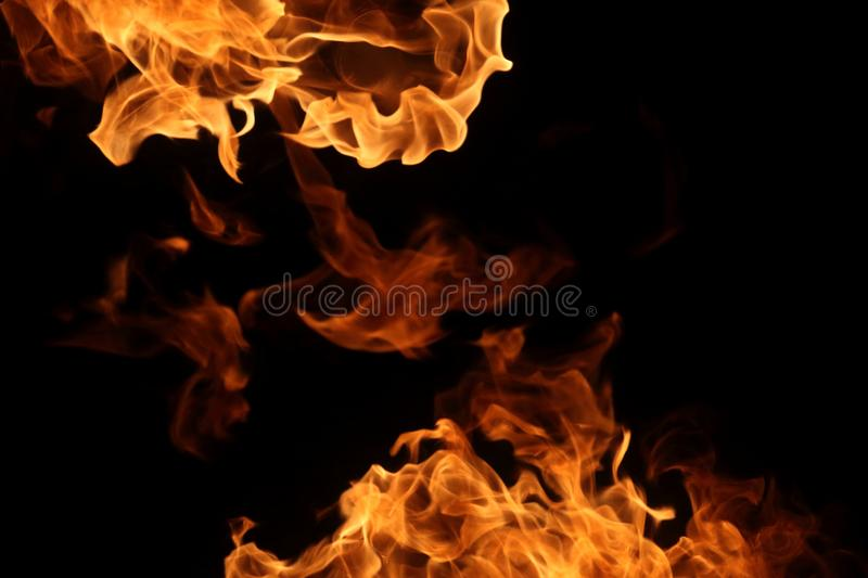 Fire burning on dark background for abstract flame texture and graphic design purpose. Fire burning on dark background for abstract flame texture and graphic royalty free stock photos