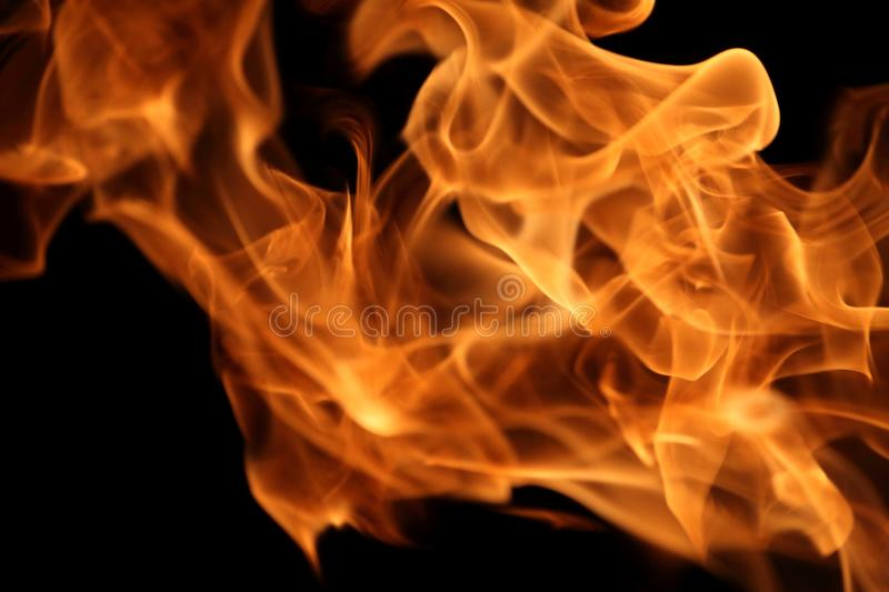 Fire burning on dark background for abstract flame texture and graphic design purpose. Fire burning on dark background for abstract flame texture and graphic royalty free stock photo