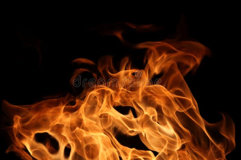 Fire burning on dark background for abstract flame texture and graphic design purpose. Fire burning on dark background for abstract flame texture and graphic stock photography