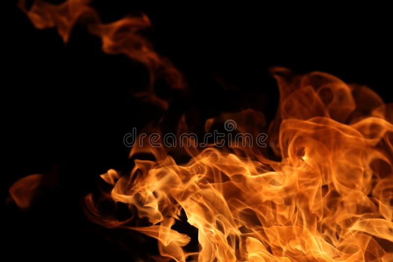 Fire burning on dark background for abstract flame texture and graphic design purpose. Fire burning on dark background for abstract flame texture and graphic royalty free stock photography