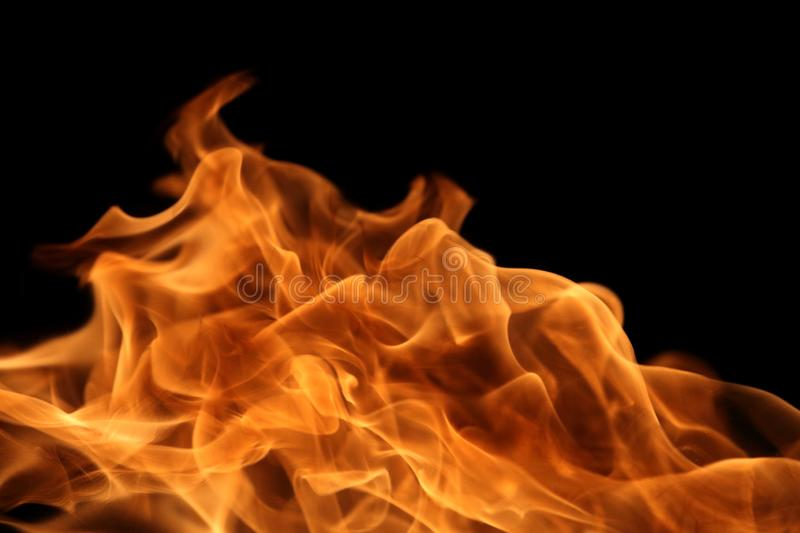Fire burning on dark background for abstract flame texture and graphic design purpose. Fire burning on dark background for abstract flame texture and graphic stock images