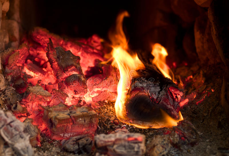 Fire burning in the furnace. Fire brightly burning in the furnace royalty free stock image