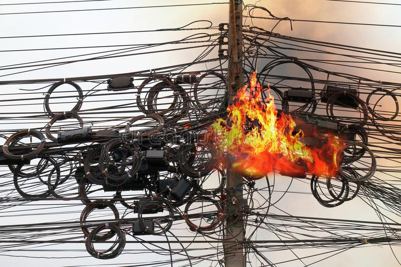 Fire burning High Voltage Cables power, Danger wire tangle cord electrical energy royalty free stock images