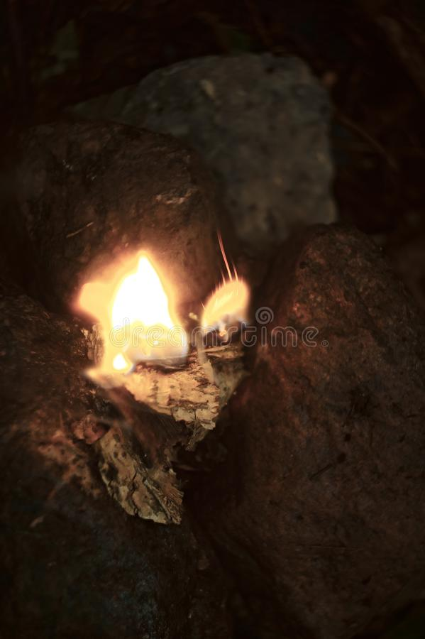 Fire burning in small rock altar from above royalty free stock image