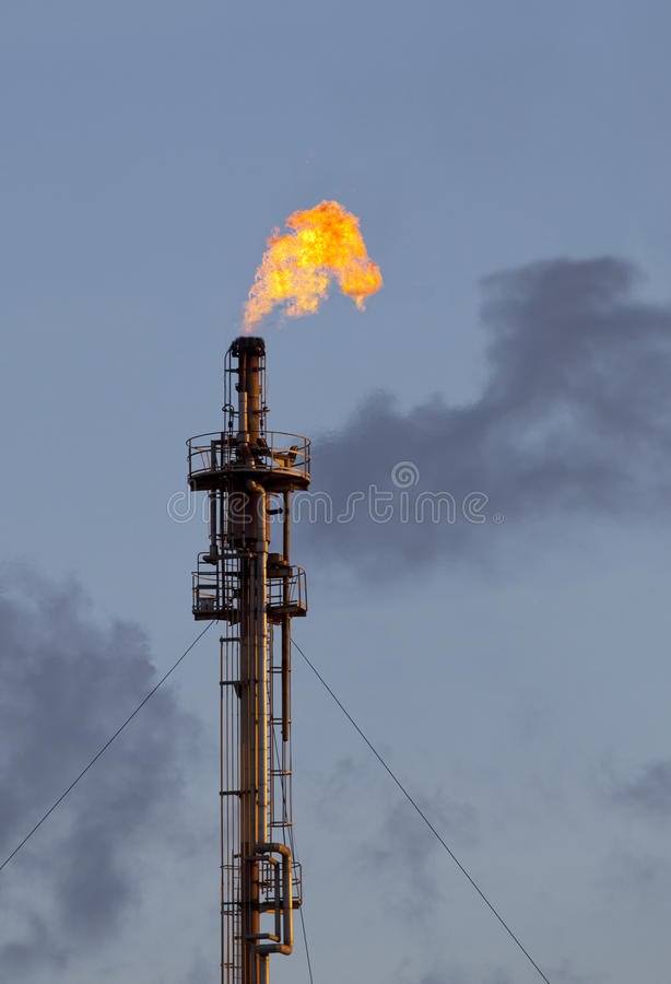 Fire burning tube in refinery petrochemical industry royalty free stock photo