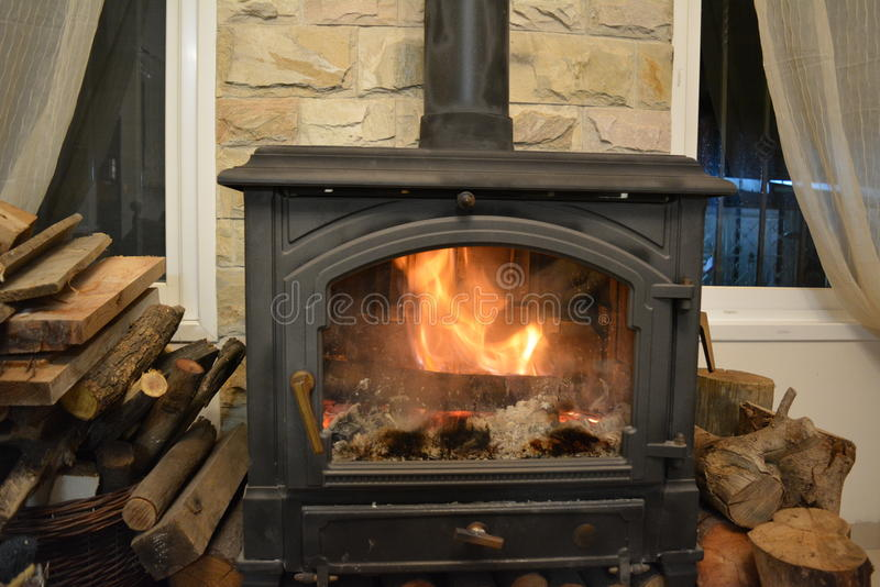 Fire burns in the fireplace royalty free stock photography