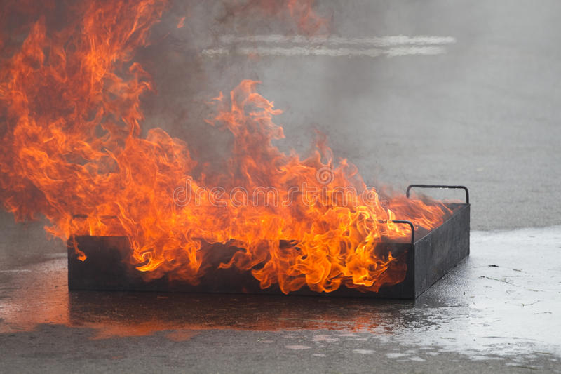 Fire burns in a training container royalty free stock photo