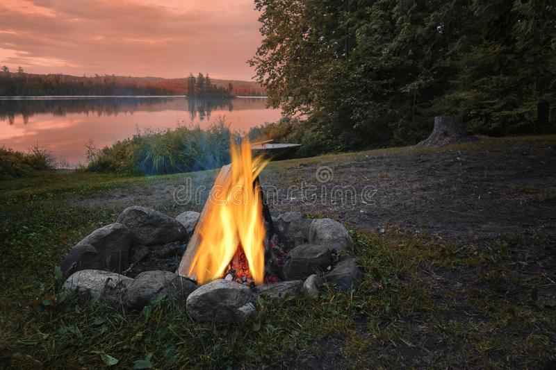 A fire camp beside a lake royalty free stock images