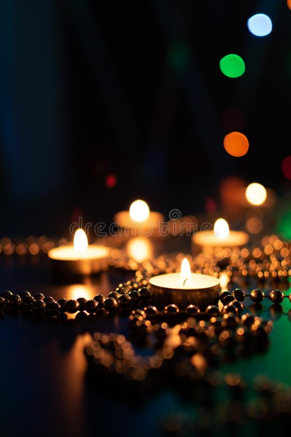 Christmas candles burning at night. Abstract candles background. Golden light of candle flame. Hope, fire. royalty free stock photo