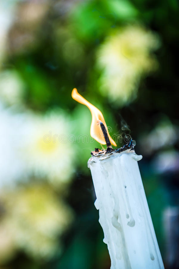 Fire on candle stock images