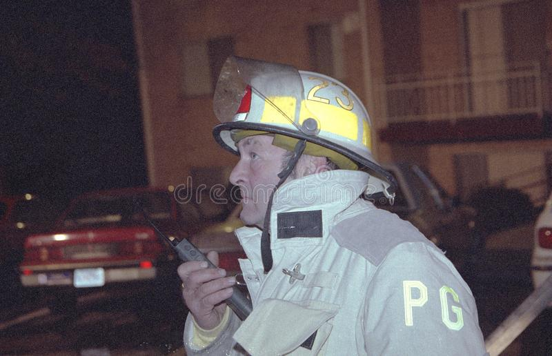 A fire chief talks on the radio at the scene of an emergency royalty free stock image