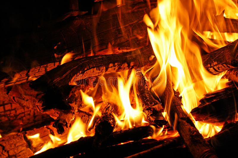 Fire from the fire. Fire from the fire close-up. The flame in the embers stock photography