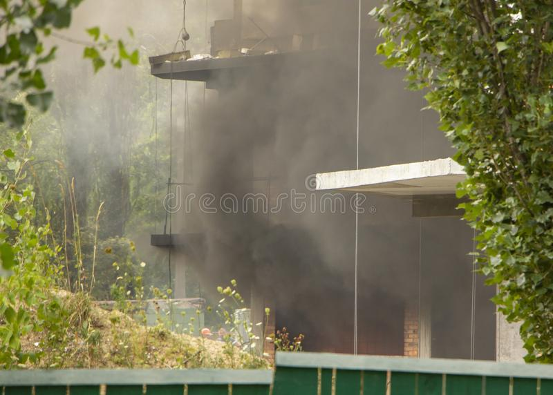 Fire At a construction site, unfinished multi-storey reinforced concrete building royalty free stock image