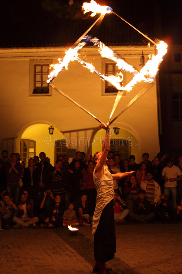 Fire cube over juggler's head. Sibiu, Romania - June 11, 2013: Sibiu International Theatre Festival. A fire show called Are there Alps in Vienna? presented by stock photography