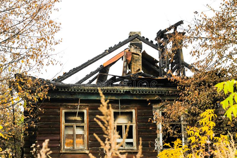 Fire-damaged traditional Russian wooden house izba in autumn. Gorokhovets. Vladimir oblast, Russia royalty free stock photography