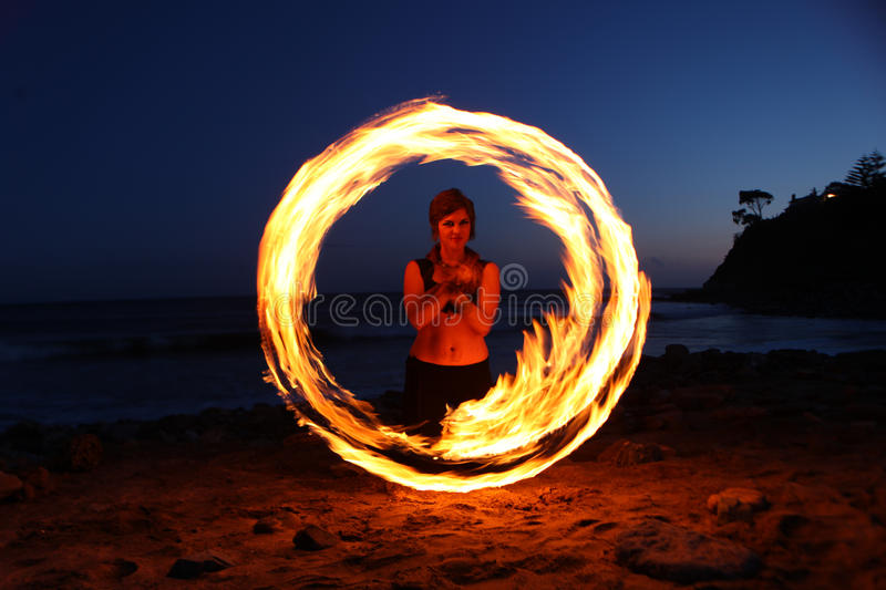 Fire Dance Along the Beach in the Dark stock photo