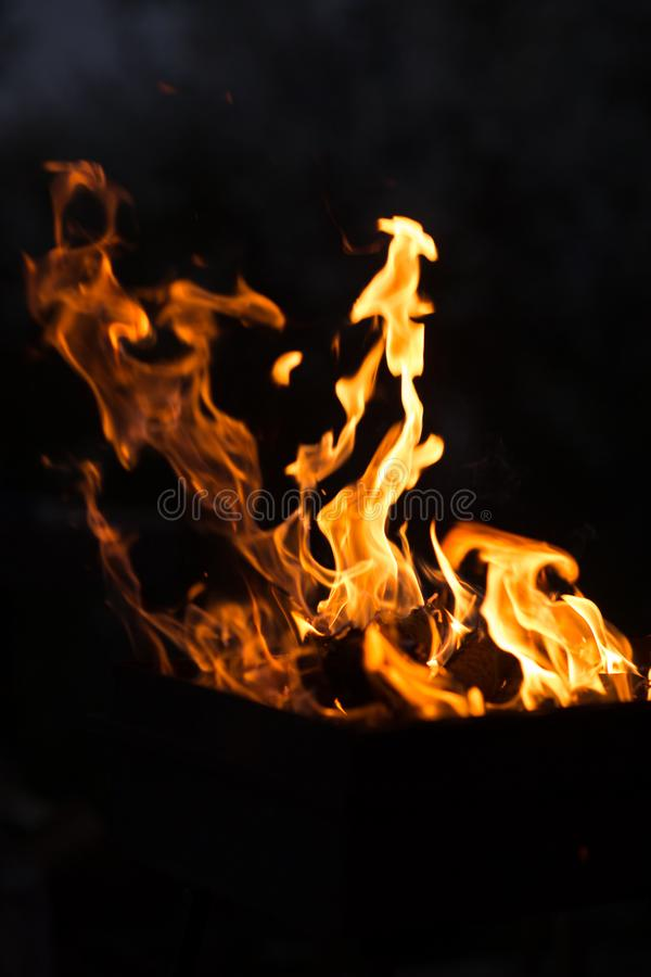 Fire dance – dancing fire at night. royalty free stock photography
