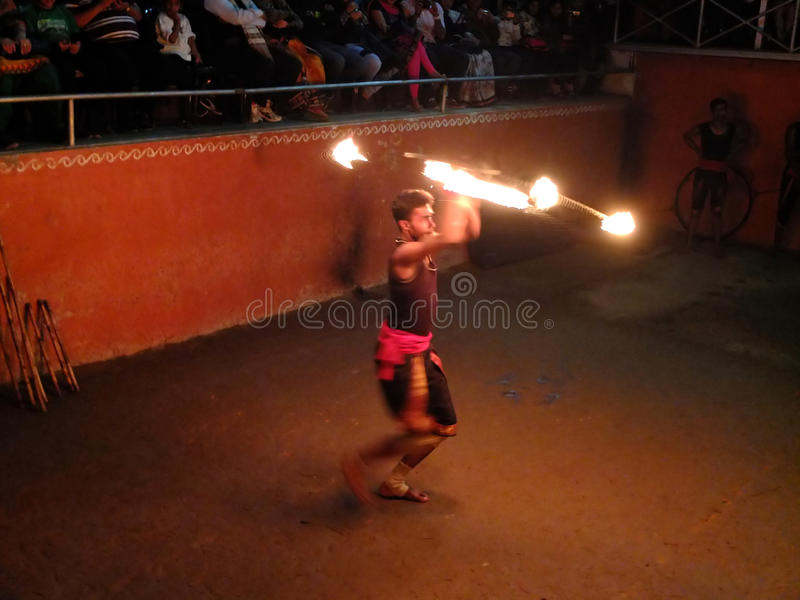 Fire dance performer. Kalaripayattu martial art expert performing fire dance in the Thirumeny cultural centre, Munnar, Kerala, India royalty free stock photography