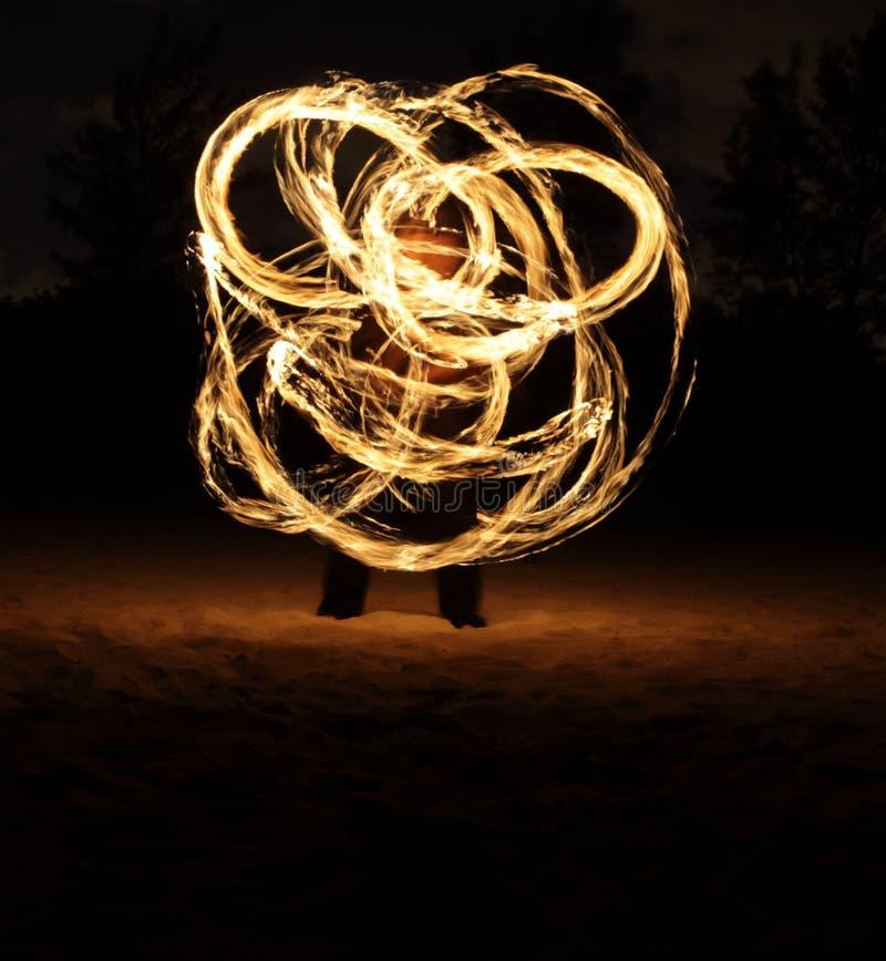 Fire Dancer in the dark stock image