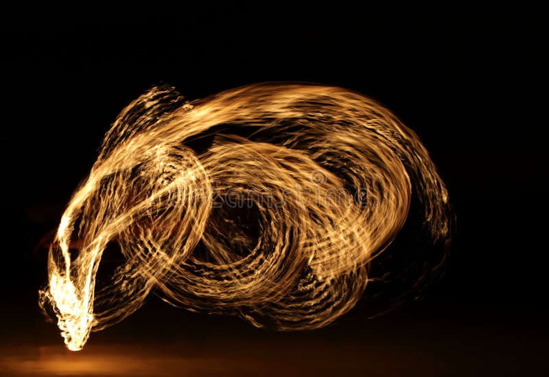 Fire Dancer in the dark stock photo