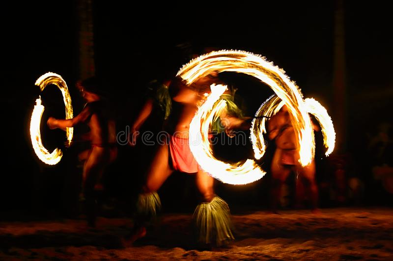 Fire dancers at Hawaii luau show. Polynesian hula dance men jugging with fire torches stock photography