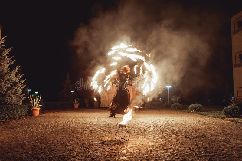 Fire dancing shows at night. Amazing fire show as part of wedding ceremony royalty free stock photography