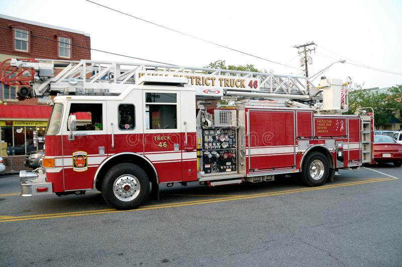A fire department aerial  ladder fire truck. From the US Naval District  Truck 46 stock image