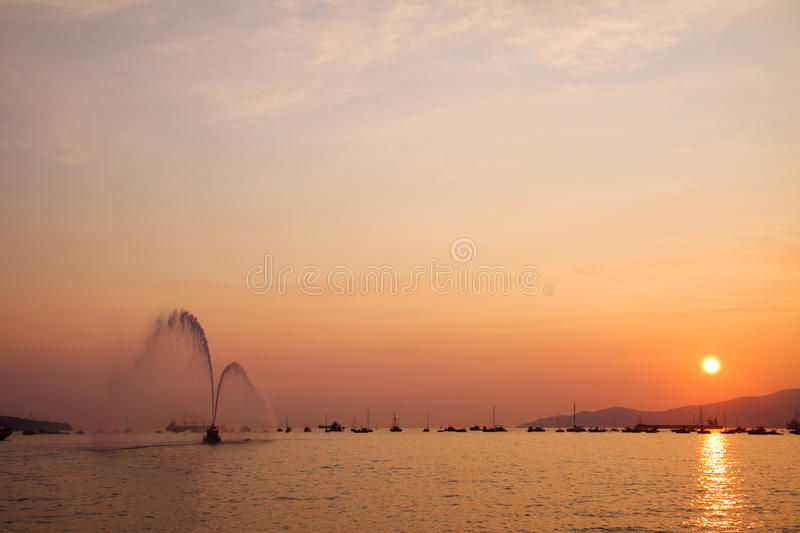 Fire department boat on display at sunset, spraying water in Eng. Lish Bay, Vancouver stock images