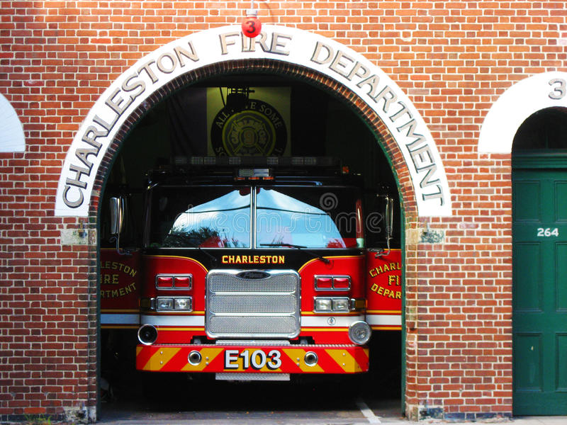 Fire department in Charleston, South Carolina. Charleston, South Carolina, USA - August 2015: a fire truck parked in its garage, ready for emergency calls. No stock images