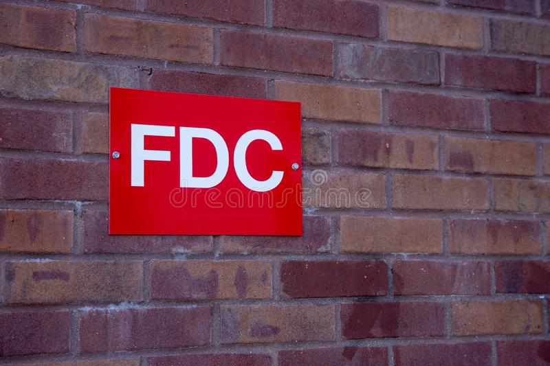 Fire Department Connection Sign on brick wall of building. To help during an emergency response stock images