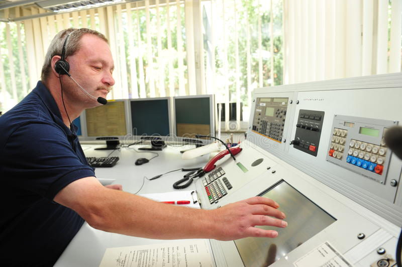 Fire department control room. Worms, Germany - Jule 21, 2009 - Fire fighter in control room of fire department Worms taking an emergency call royalty free stock photos