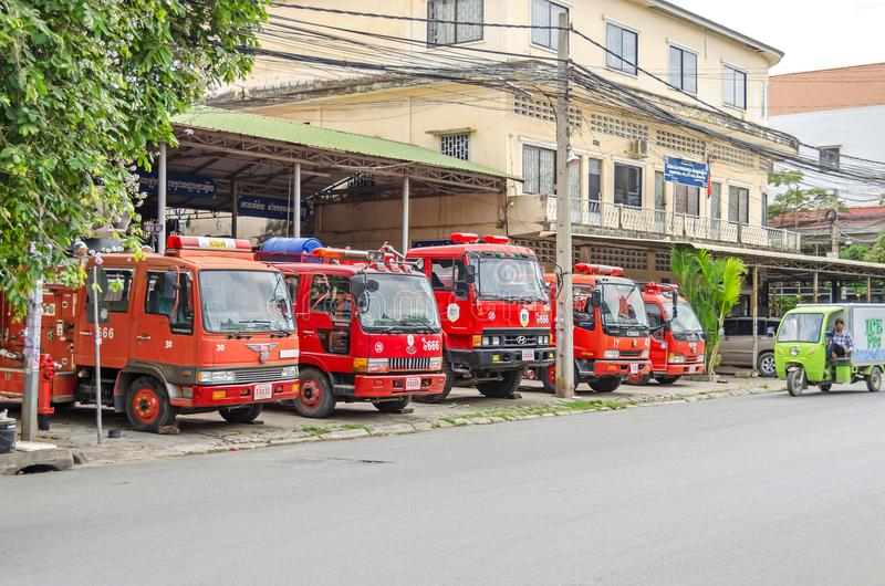 Fire department with fire trucks in Phnom Penh, Cambodia. Phnom Penh, Cambodia - April 8, 2018: View of the municipal fire department at the street 330 with fire royalty free stock photos