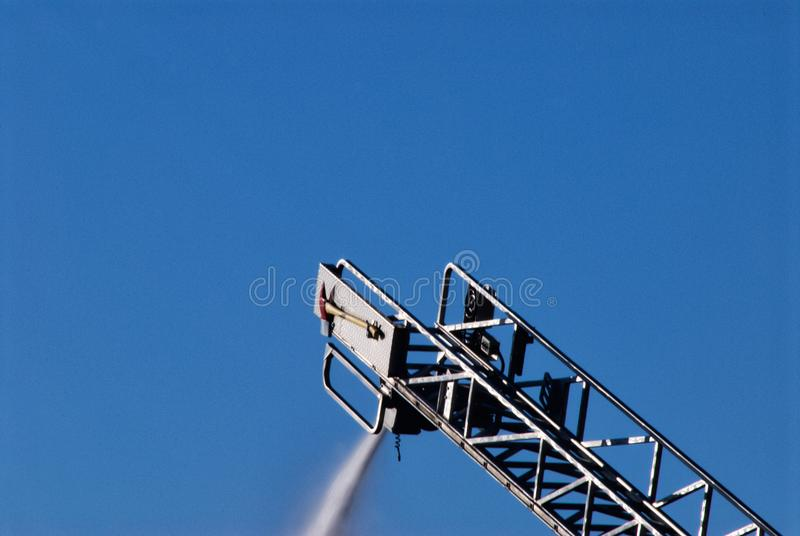 Fire Department Ladder Spraying Water onto a Fire royalty free stock images