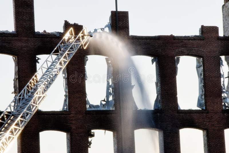 Fire department putting out a fire in a building royalty free stock photography