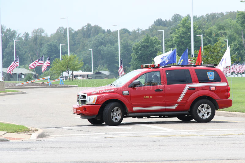 Fire Department SUV. A fire department emergency vehicle. A red SUV with emergency lights stock image