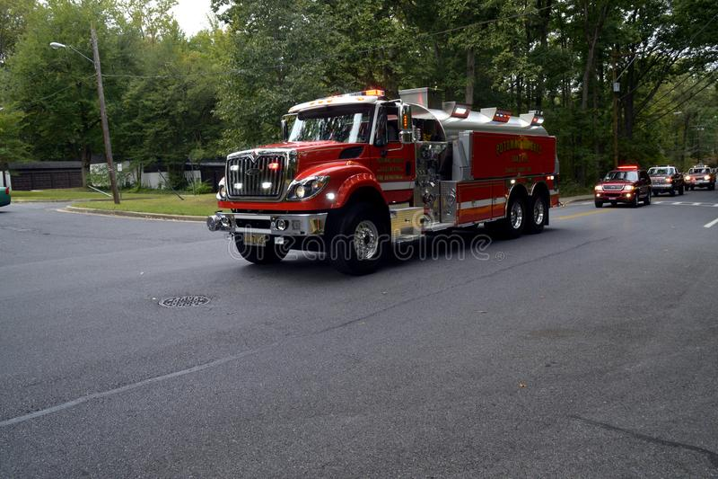 Fire Department Tanker on a call. A fire department tanker from The Potomac Heights Volunteer Fire Department repsponding on a emergency call stock photography