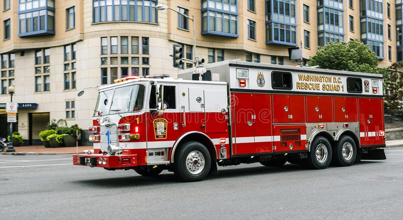 Fire department truck in emergency Washington DC. Washington June 2017 US: Emergency truck across the streets of Washington downtown, Rescue Squad 1 with bright royalty free stock photography