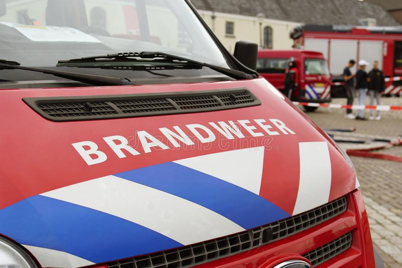 Fire Department vehicles Dutch: Brandweer. Fire Department in Dutch: Brandweer Vehicle, commander van. Safety car when accidents happen. People standing in the stock photos