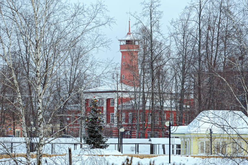 Fire department with watchtower in Ulich, Russia. Building of fire department with watchtower in Ulich at winter day. Building was built in years 1809-1811 on royalty free stock photos