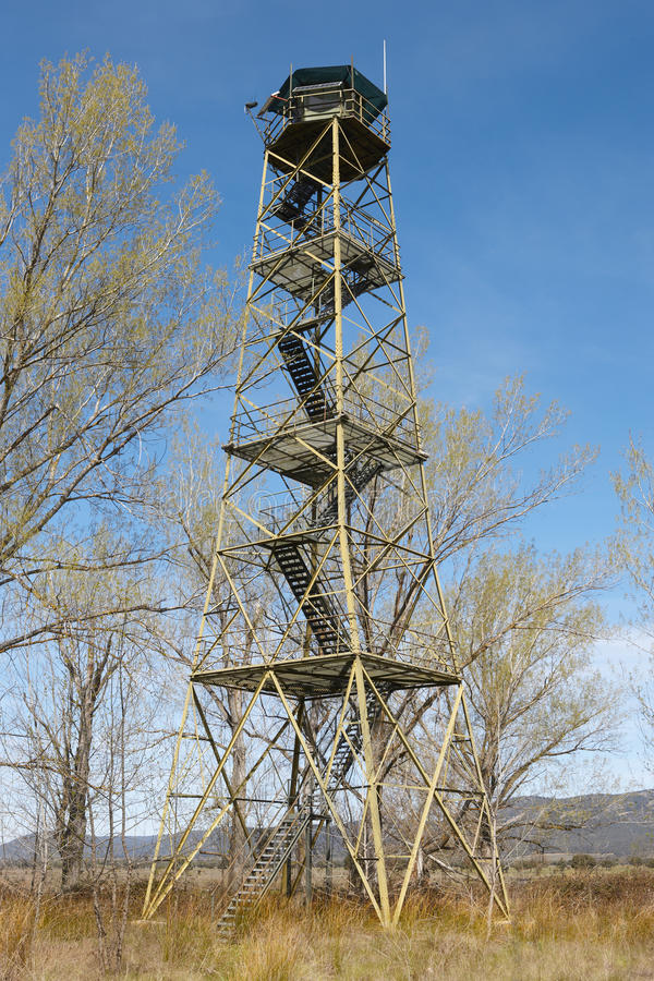 Fire detection watch tower surruonded by deciuous trees in Spain. Vertical royalty free stock photos